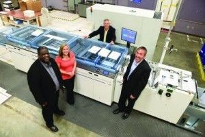 In-line finishing on the inkjet presses—comprising a buffer, cutter, separator and stacker—has greatly enhanced productivity and efficiency. From left: Eric Seldon, Gillian Seguin, Frank Butler and Mike Thomas.